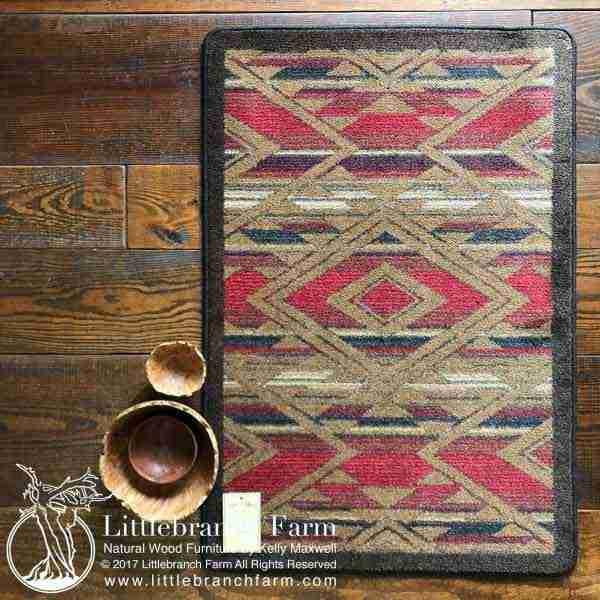 Red and brown Southwestern area rug on hardwood floor