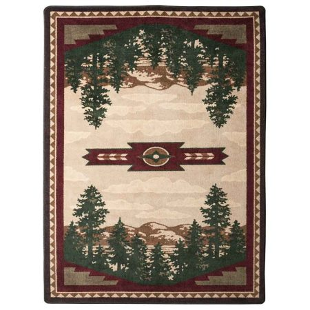 Area rug with a mountain landscape print on a tan background