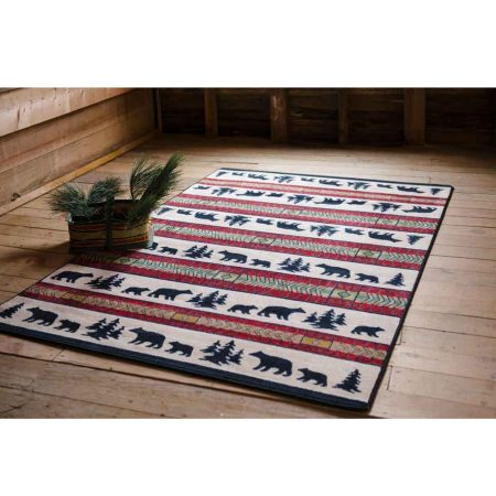 Rustic rug with bear and pine tree stripes alternating with red stripes