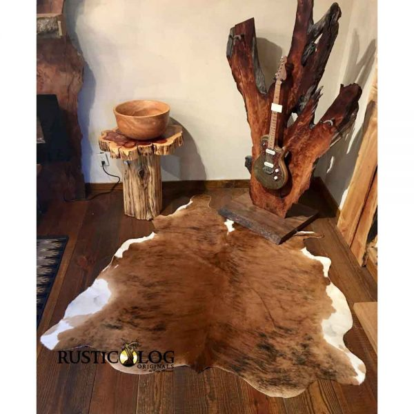 Room scene with live edge guitar stand with dark brindle cowhide used as area rug