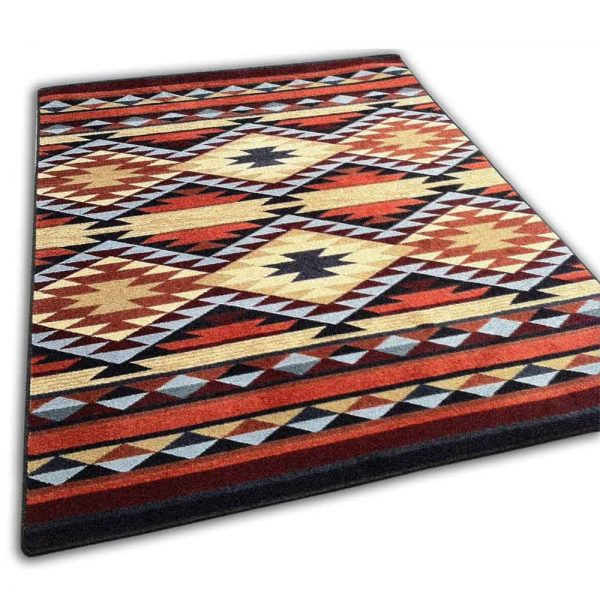 Southwestern area rug with diamond pattern in rust, yellow, and blue