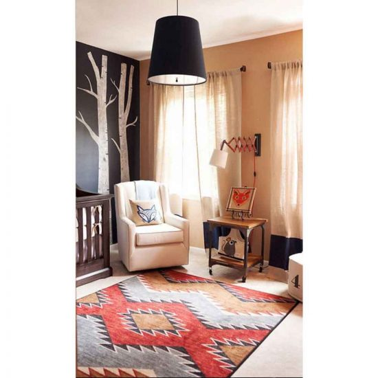 Contemporary baby bedroom with red, brown, and blue area rug