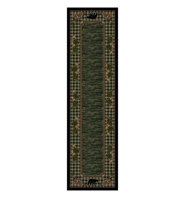 Green runner rug with a plaid border with black bear and pine cone motif