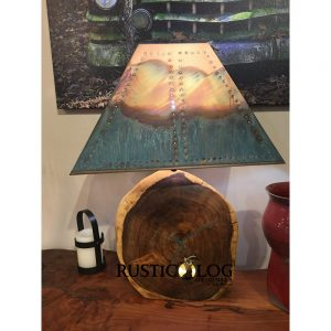 Table lamp with a copper shade and a solid round mesquite base
