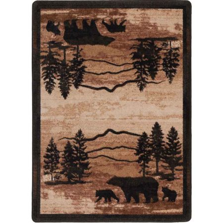 Area rug with mountain landscape and bear design in shades of brown