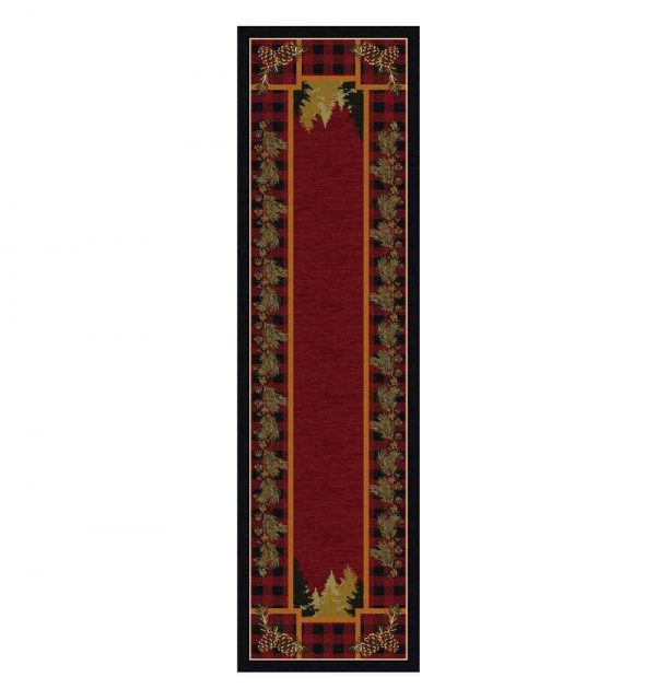 Runner rug with a red background and a rustic print border