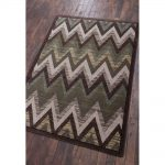 Multi muted green zigzag print area rug