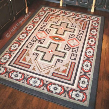 Southwest tan rug with cross print on a hardwoodfloor