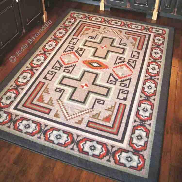 Southwest tan rug with cross print on a hardwoodfloor