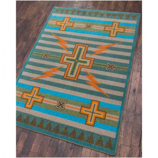 Turquoise and gray area rug with crosses and yellow accents