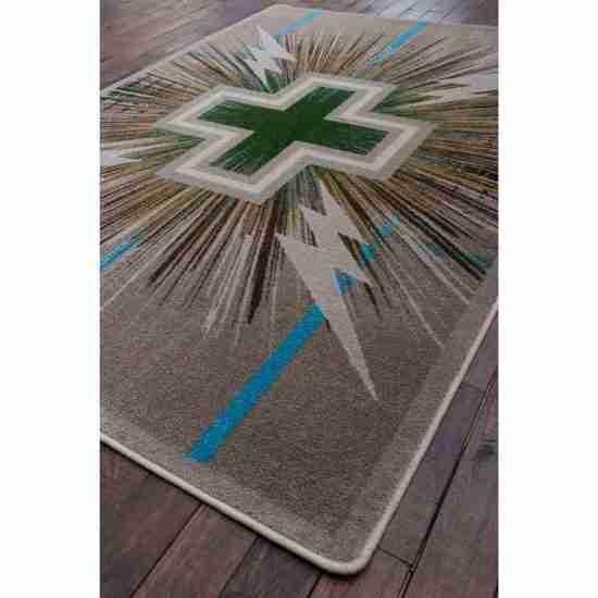 Angled Shot of Southwestern area rug with cross print on hardwood floor