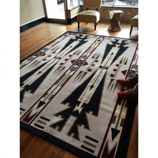 Southwest neutral area rug covering hardwood floor