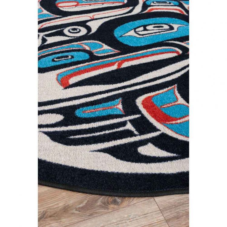 Red and blue Native American rug with a raven design