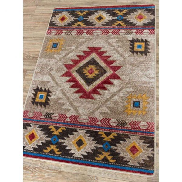 Neutral beige area rug with red and yellow Southwestern motifs
