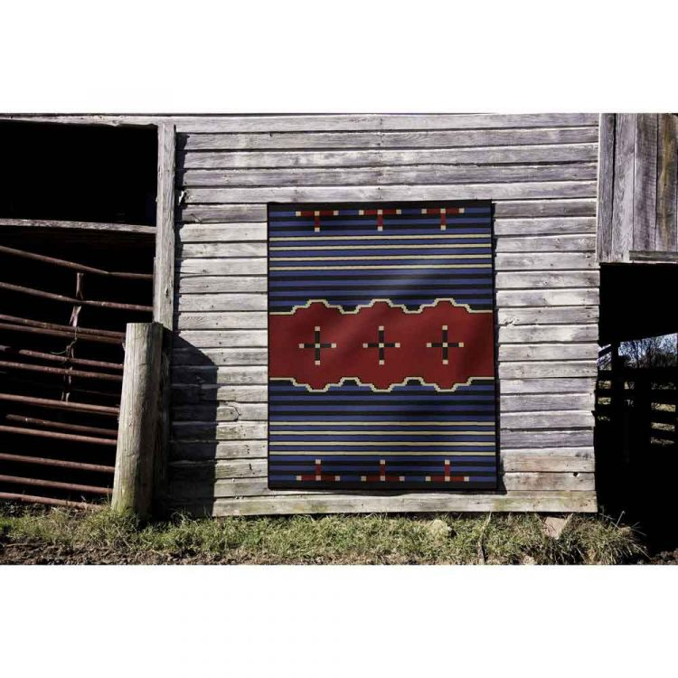 Blue And Red Area Rug Hanging On Barn Wall