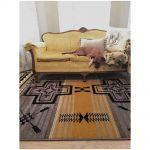 Yellow couch on gold and grey Southwest area rug