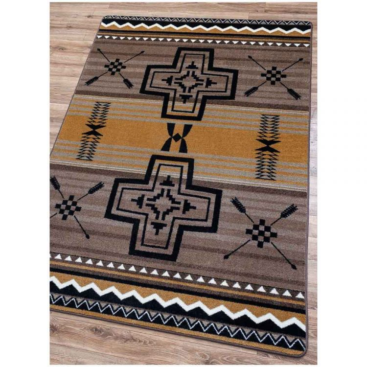 Southwestern rug with a cross and arrow pattern on a gold and gray background