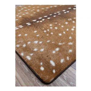 Close up of faux deer hide area rug