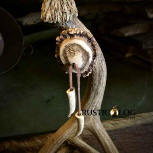 Close up shot of the base on a rustic antler table lamp