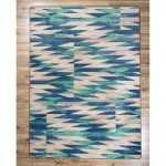 Turquoise and beige chevron print area rug