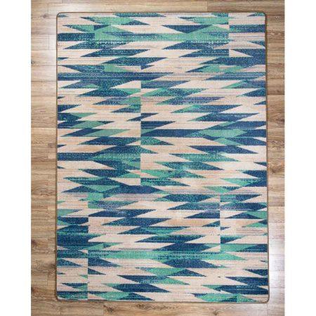 Turquoise and beige chevron print area rug