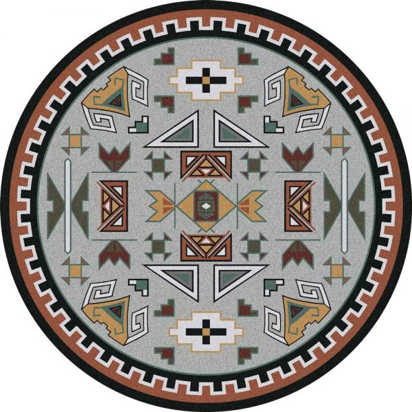 Round area rug with a gray background and rust Southwestern motifs