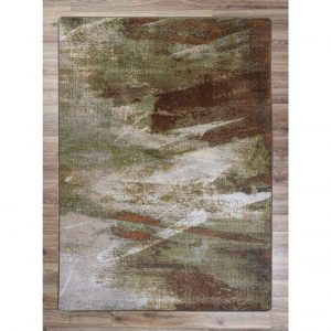 Area rug in muted shades of green and brown with an abstract print
