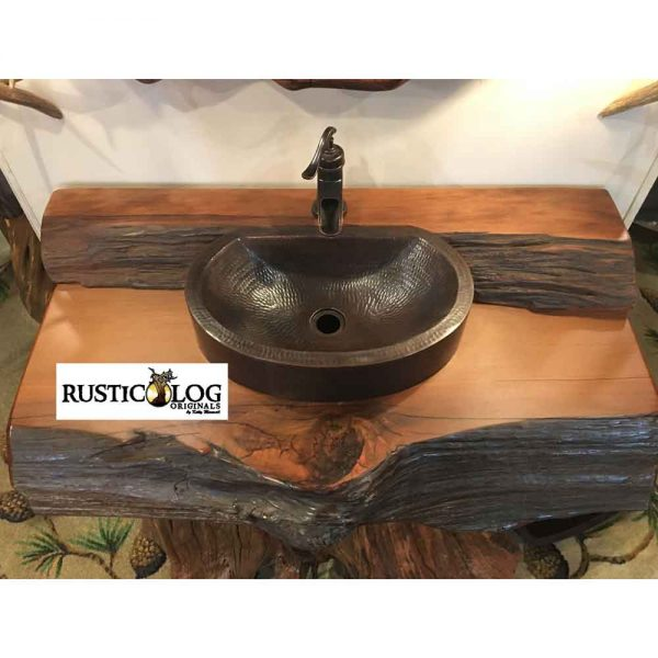Coppper vessel sink installed in rustic wood vanity