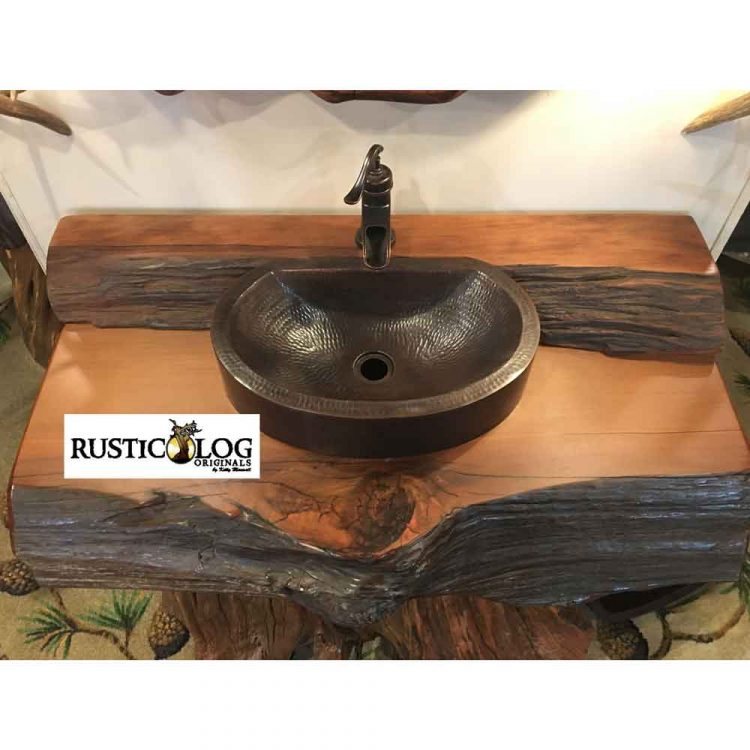 Coppper vessel sink installed in rustic wood vanity