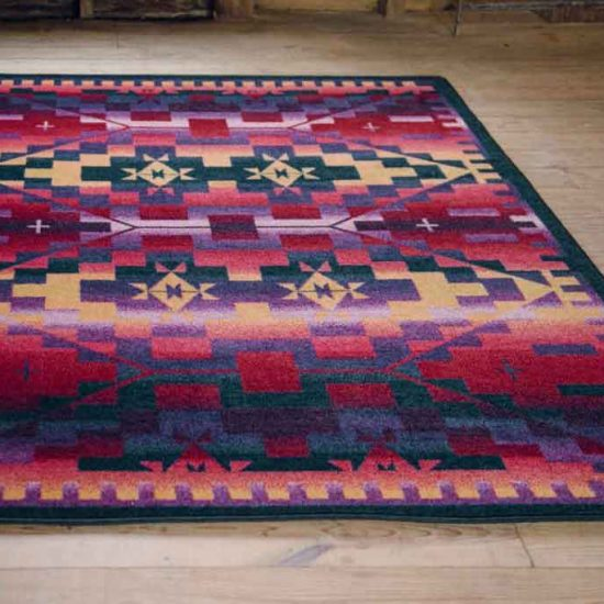 Area rug with southwest design in purple