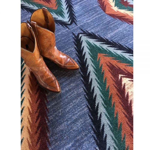 Boots on a blue Southwest area rug