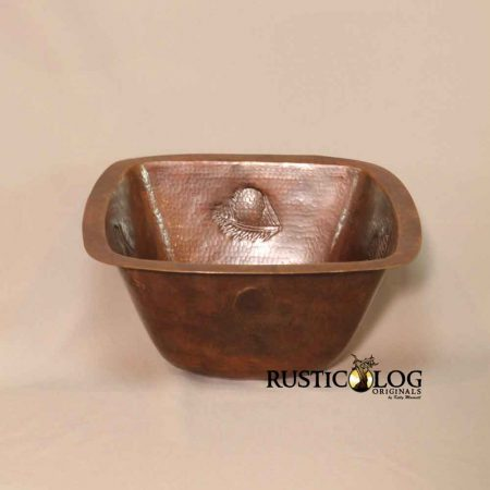 Square sink in copper with embossed pine cone