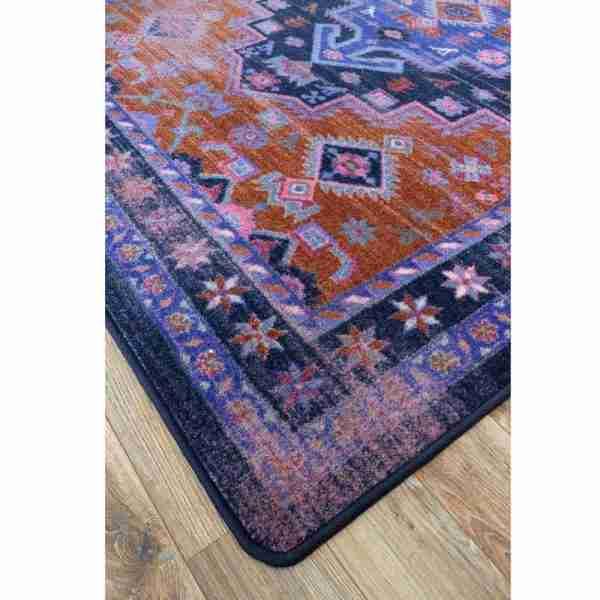 Corner of oriental print area rug