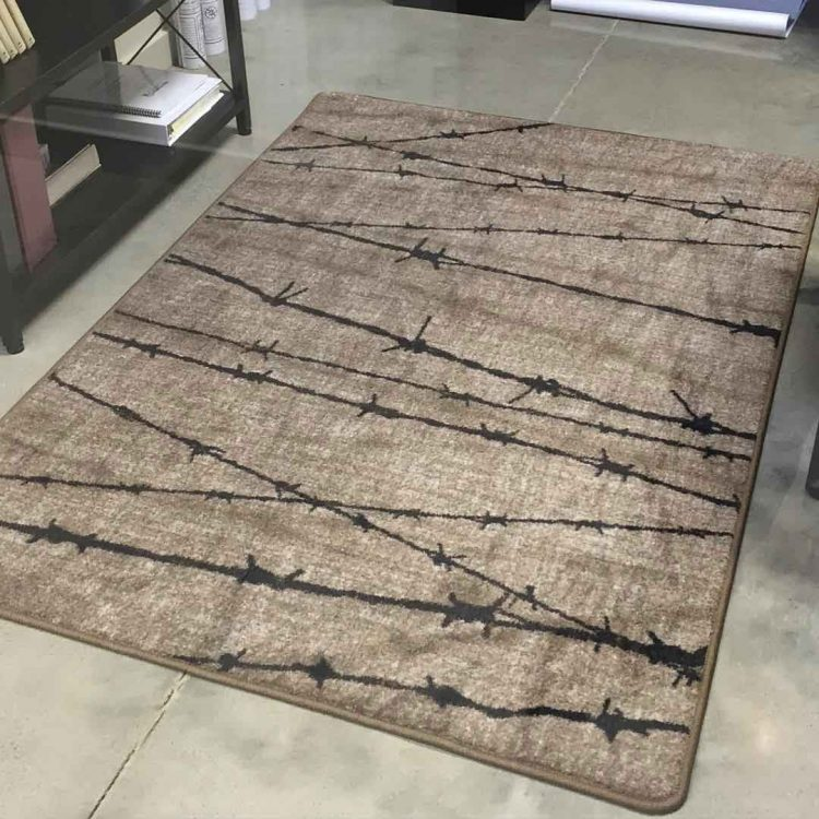 Gray area rug with a barbed wire print