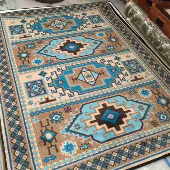 Southwestern area rug in shades of turquoise and indigo