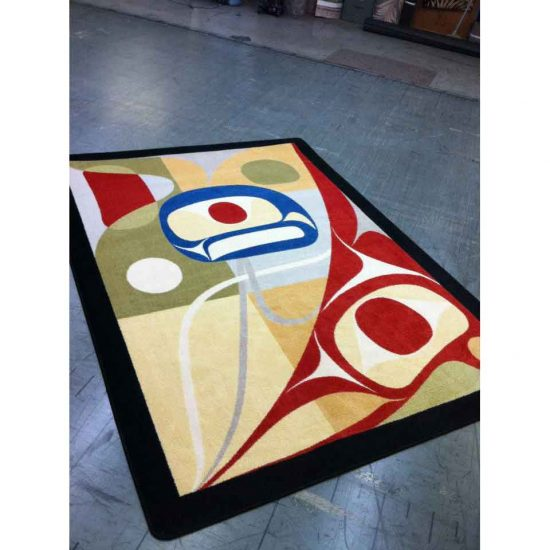 Multicolor area rug with Native masks pattern