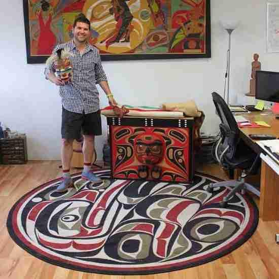 Rande Cook in his studio standing on Raven round rug