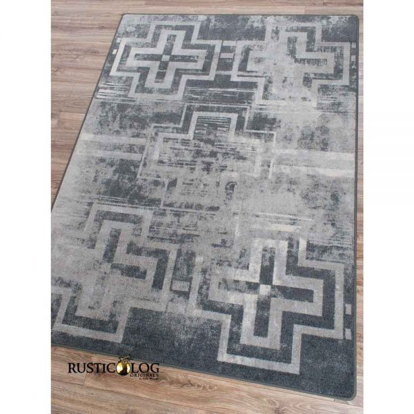 Southwestern area rug with faded crosses in shades of gray