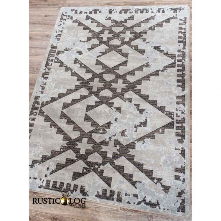 Area rug with a distressed Southwestern pattern in shades of gray