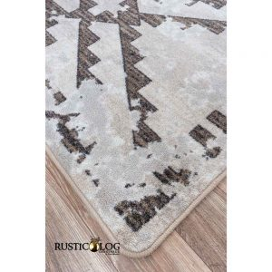 Close up shot of a gray rug with a Southwestern design