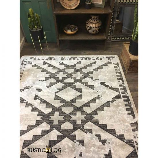 Southwestern area rug with distressed native pattern in taupe and gray
