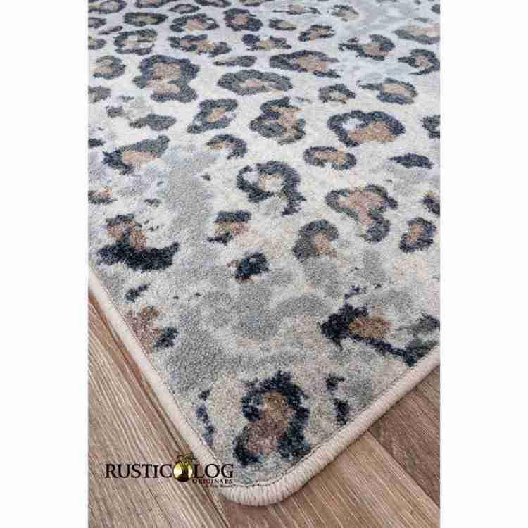 Close up shot of a leopard print area rug