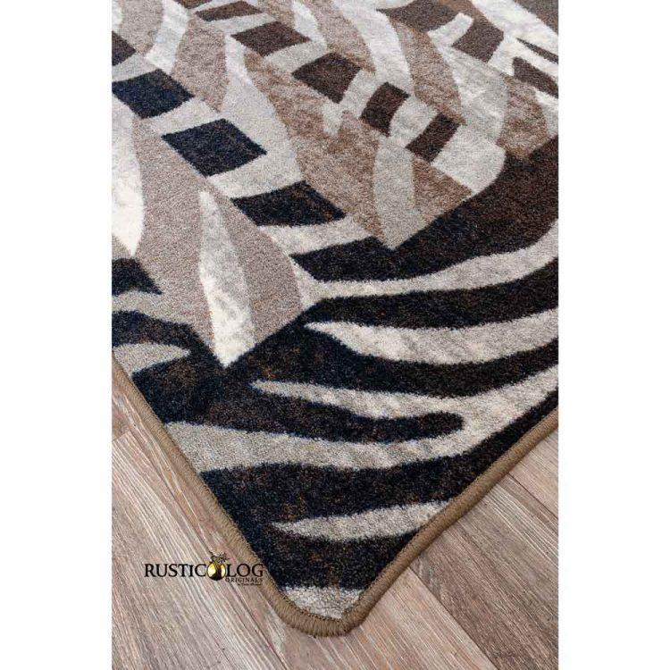 Closeup of the corner of an area rug with a zebra pattern