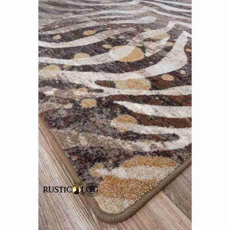Corner of an area rug with zebra stripes and gold splash print
