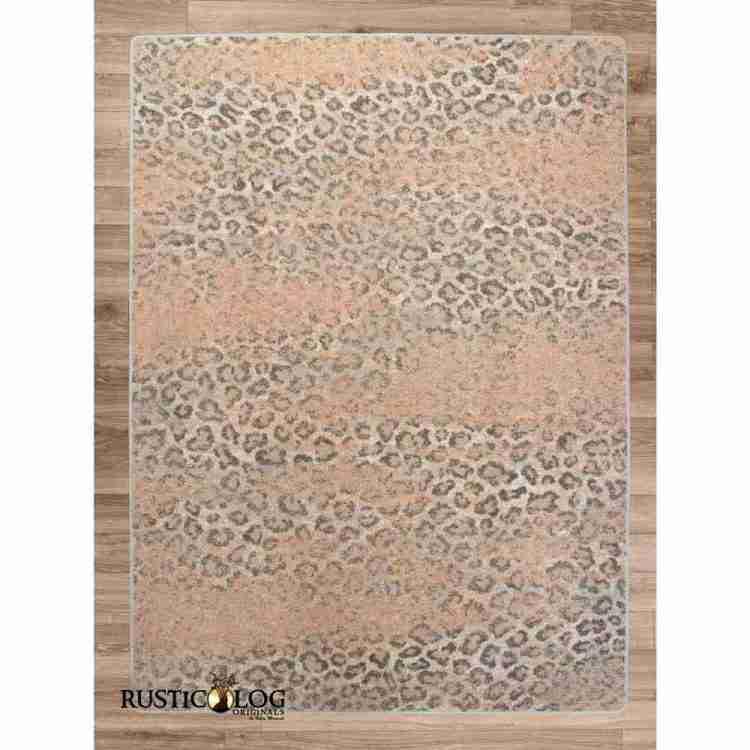 Gray and pink leopard print rug on hardwood floor