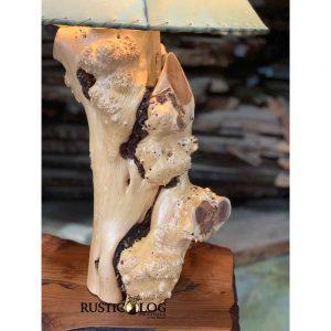 Table lamp base made from a juniper log with a cluster of burls