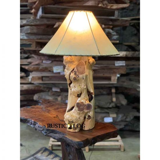 Rustic table lamp with a juniper log base and a rawhide shade