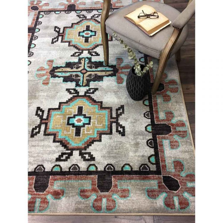 Area rug with a tan background and turquoise and rust prints