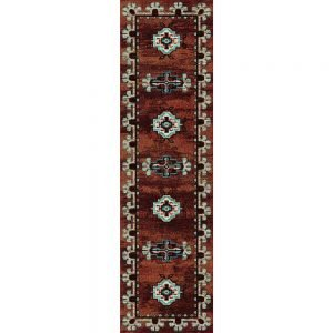 Runner rug with native patterns on a rust background