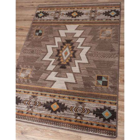 Area rug with Southwestern designs in tan, turquoise, and orange on a brown background